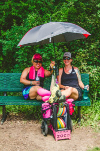 women disc golfers with umbrella