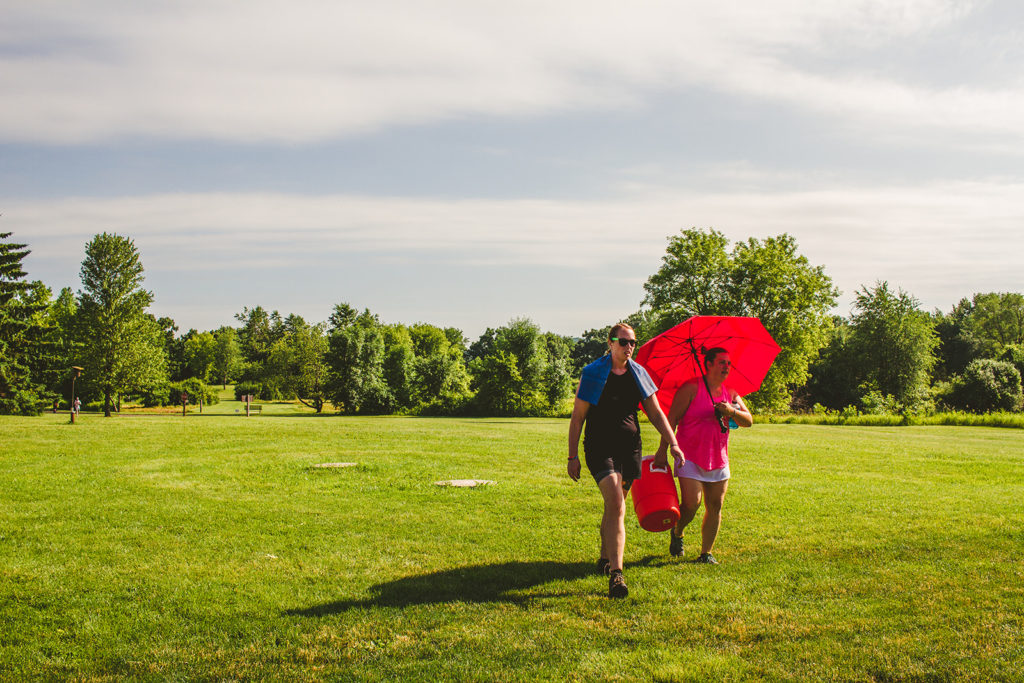 Women Carrying Water on a Disc Golf Course